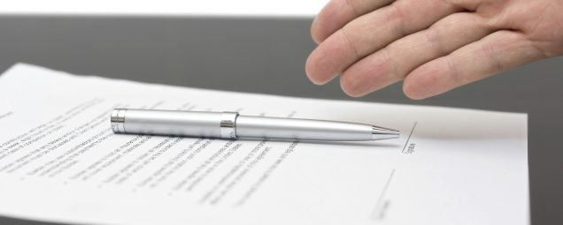 Businessman offering to sign a contract size for slide